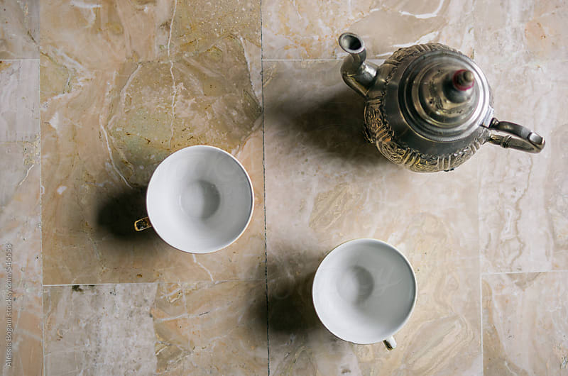 Empty teacups on marble by Alessio Bogani for Stocksy United