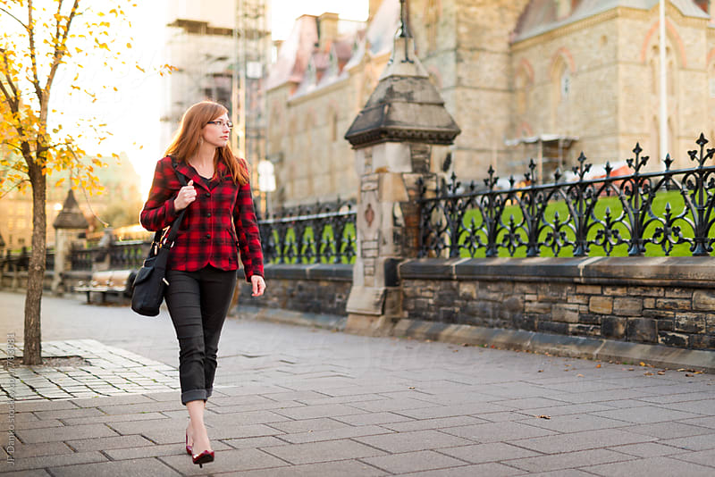 Stylish Canadian Woman Walking On Street In Front of Parliament Hill Ottawa Canada by JP Danko for Stocksy United