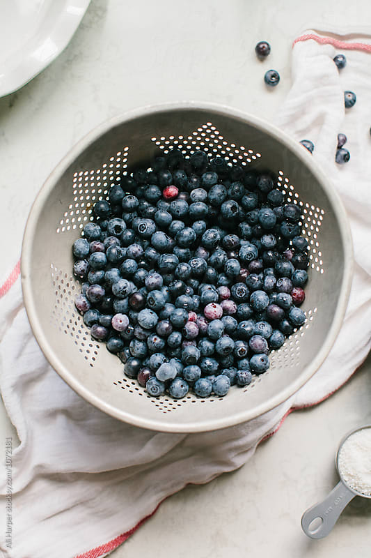 Making blueberry pie by Ali Harper for Stocksy United