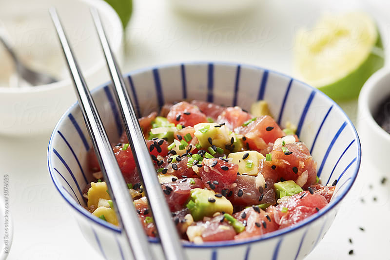 Delicious tuna tartare with chopsticks by Martí Sans for Stocksy United