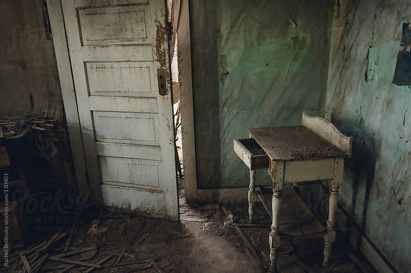 A decaying room in a long-abandoned house by Rachel Bellinsky for Stocksy United