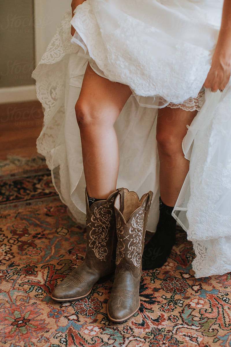 Bride Putting on Cowboy Boots for