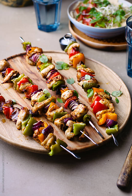 Chicken shish kebabs with salad. by Darren Muir for Stocksy United
