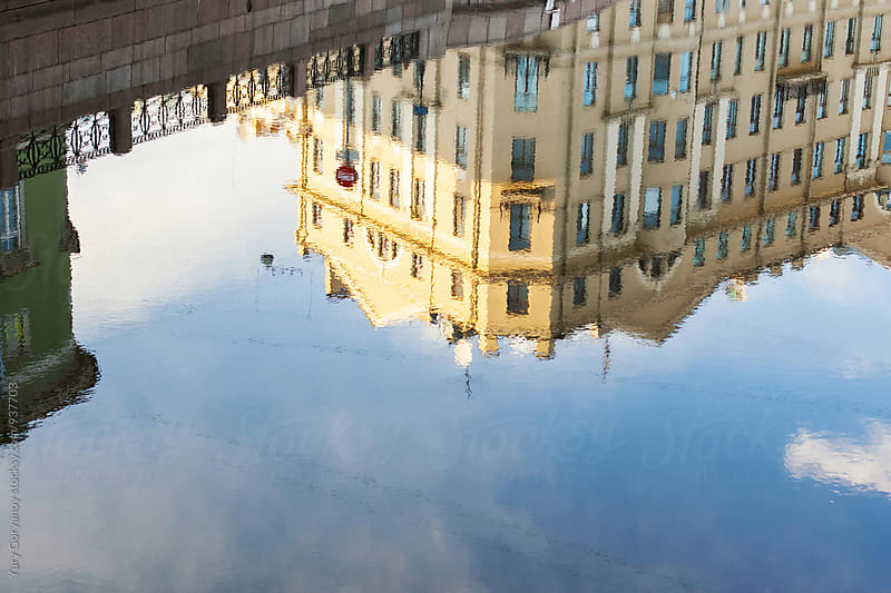 Reflection of the city on the water by Yury Goryanoy for Stocksy United