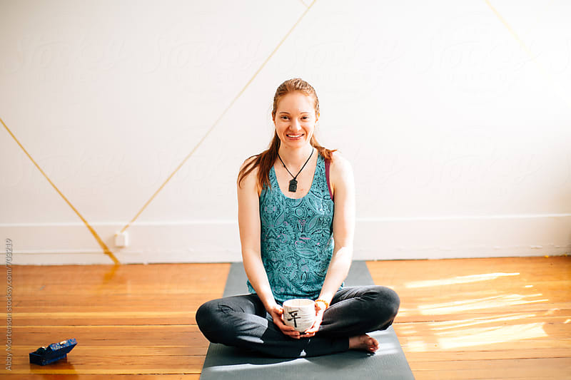 Smiling Yoga Girl Sitting in Studio by Abby Mortenson for Stocksy United