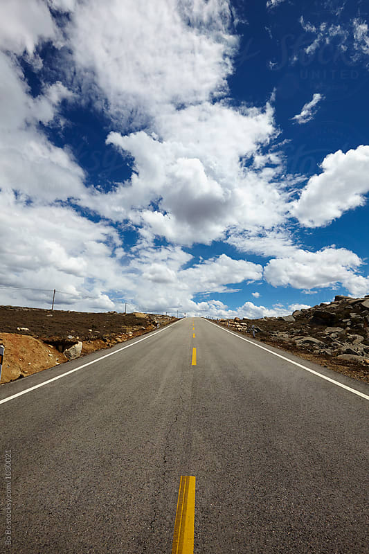 straight road under sky by Bo Bo for Stocksy United