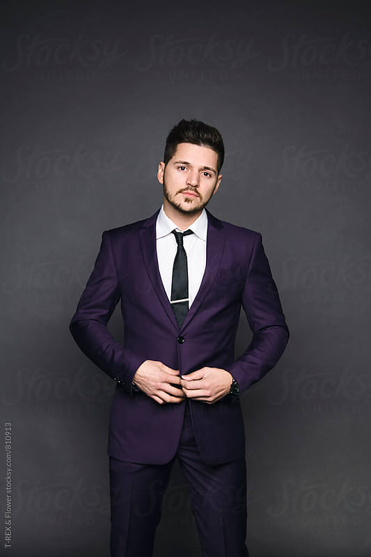 Portrait of handsome bearded man in suit by Danil Nevsky for Stocksy United
