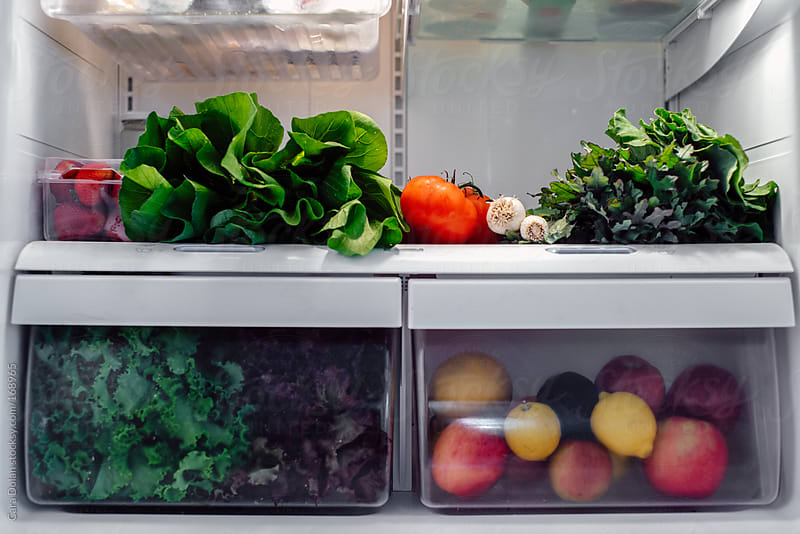 Refrigerator filled with fresh fruits and vegetables by Cara Dolan for Stocksy United