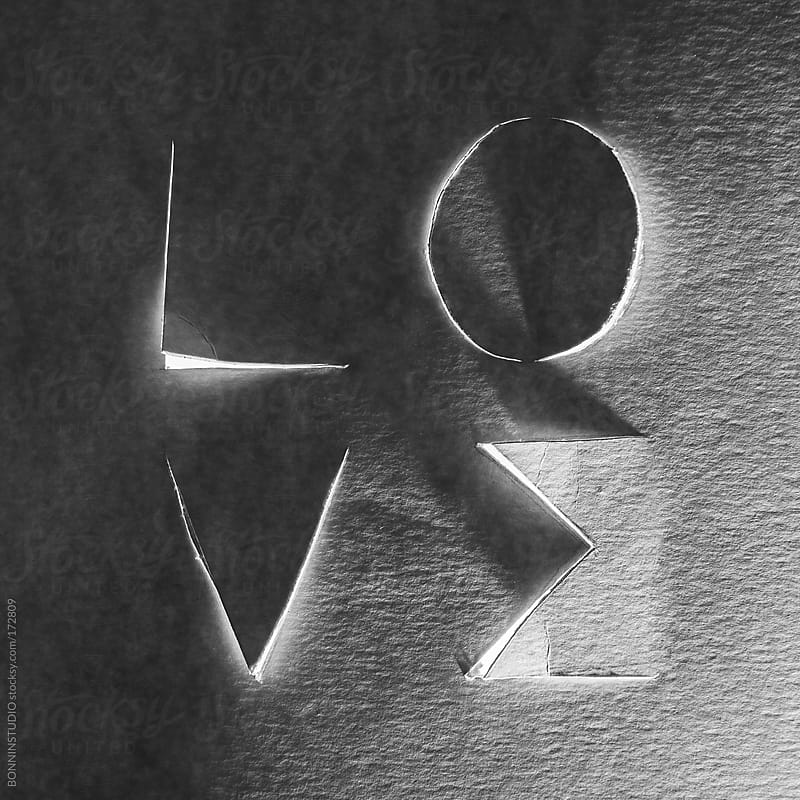 Love word cropped on cardboard. Black and white photo. by BONNINSTUDIO for Stocksy United