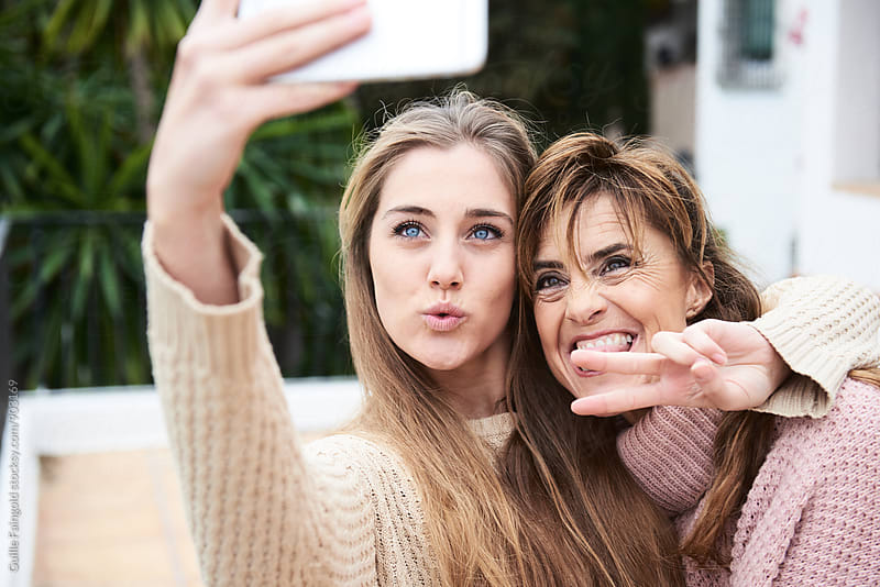 Two women making selfie by Guille Faingold for Stocksy United