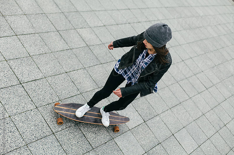 Young woman riding Longboard by VegterFoto for Stocksy United