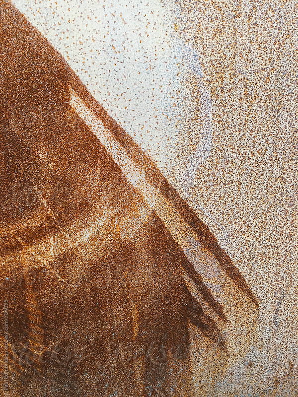 Close up of patterns and textures on rusty metal wall by Paul Edmondson for Stocksy United