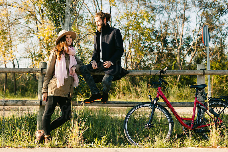 Hipster couple enjoying a sunny autumn day in the forest. by BONNINSTUDIO for Stocksy United