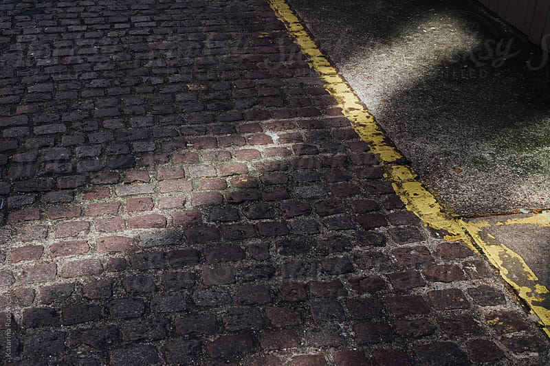 Streak of Light on a Pavement in London by Katarina Radovic for Stocksy United
