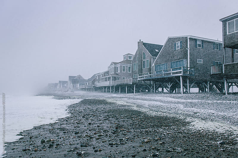 Seaside Home Exposed in Winter Snowstorm by Raymond Forbes LLC for Stocksy United