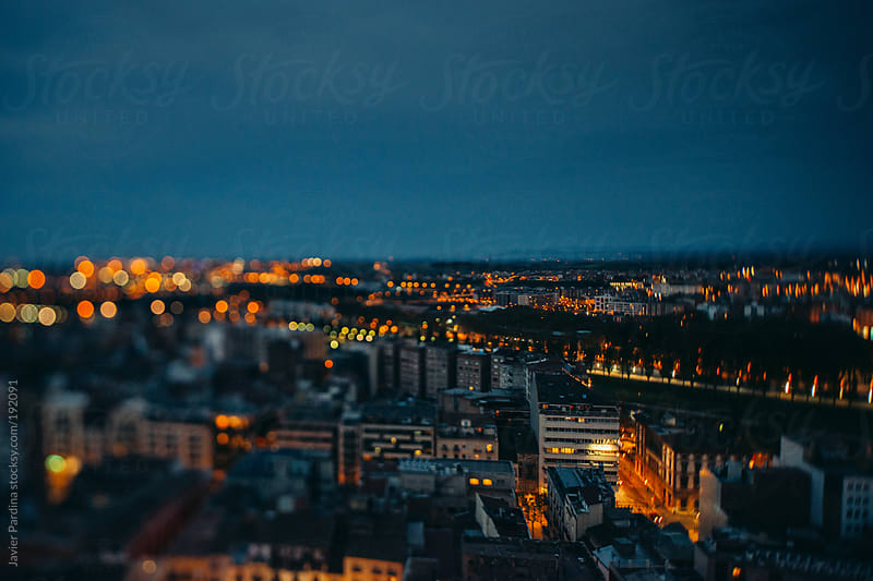 aerial view of a mediterranean city at night by Javier Pardina for Stocksy United