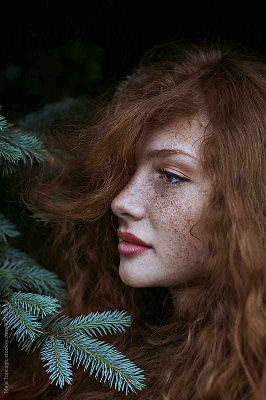 Portrait of a beautiful redhead with freckles  by Maja Topcagic for Stocksy United