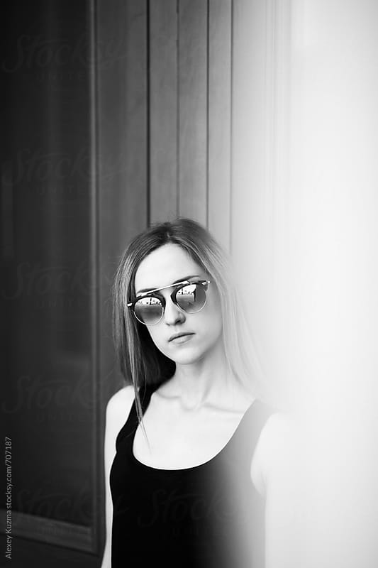 portrait of real young woman with  sunglasses by Alexey Kuzma for Stocksy United