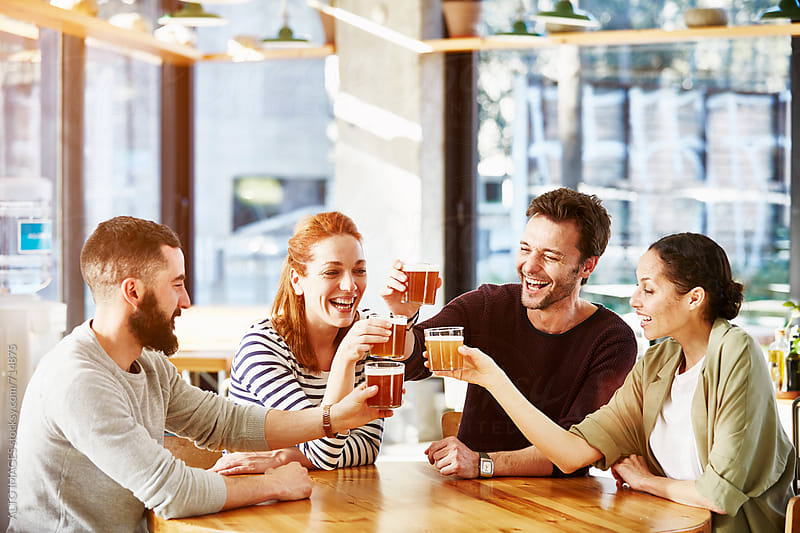 Business Friends Toasting Beer In Restaurant by ALTO IMAGES for Stocksy United