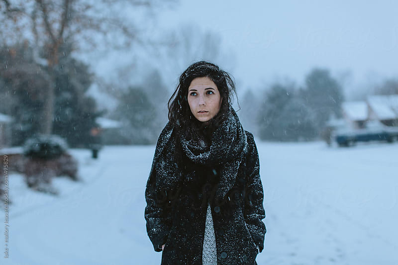 Girl in the snow by luke + mallory leasure for Stocksy United