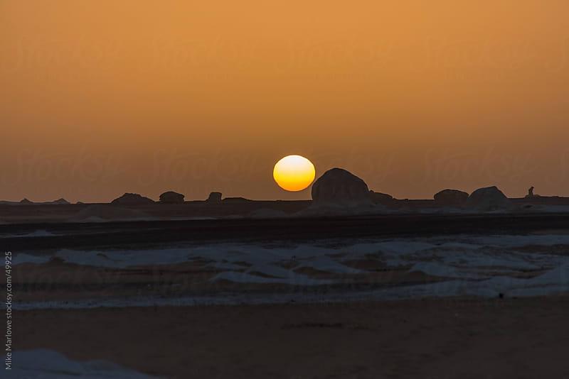 Sunrise over the white desert of Egypt. by Mike Marlowe for Stocksy United