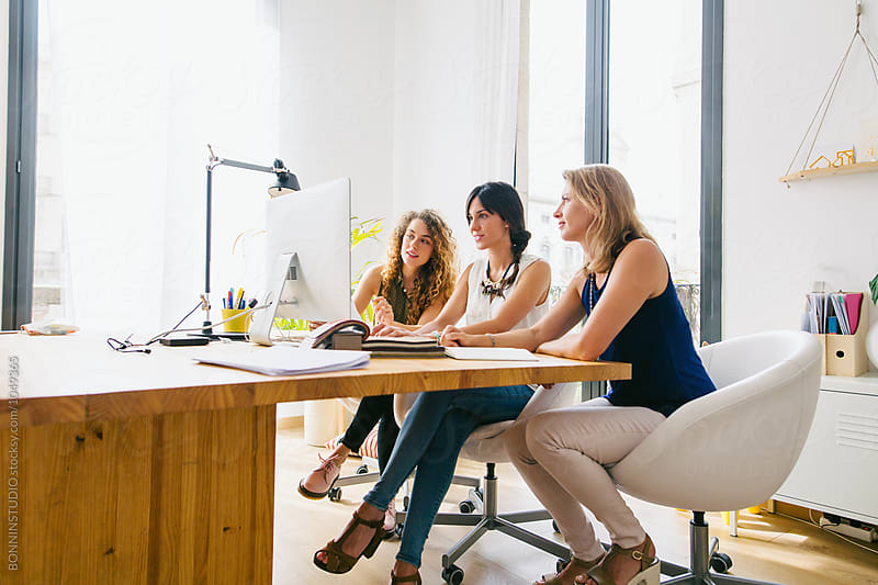Female team working together in a beautiful studio. by BONNINSTUDIO for Stocksy United
