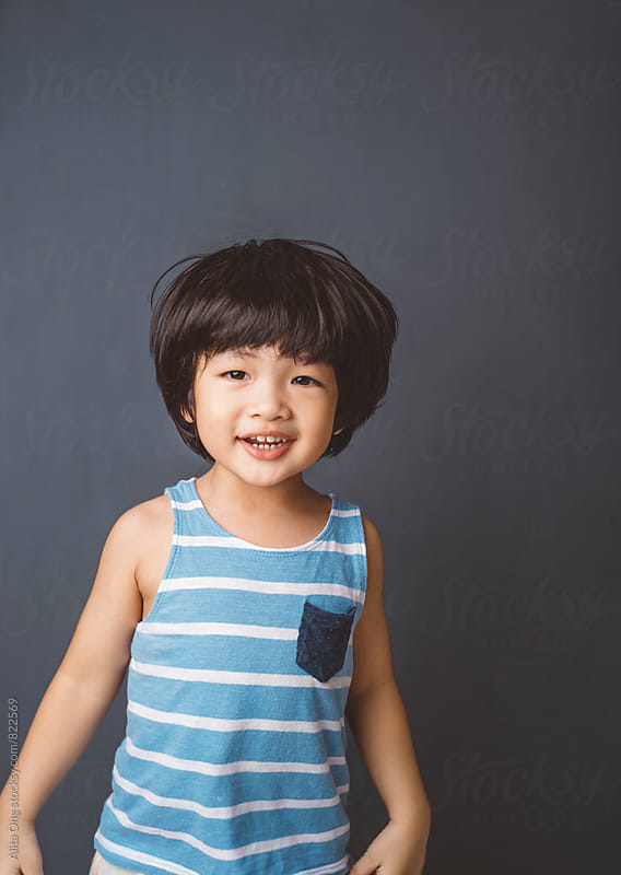 Portrait of happy little boy by Alita Ong for Stocksy United