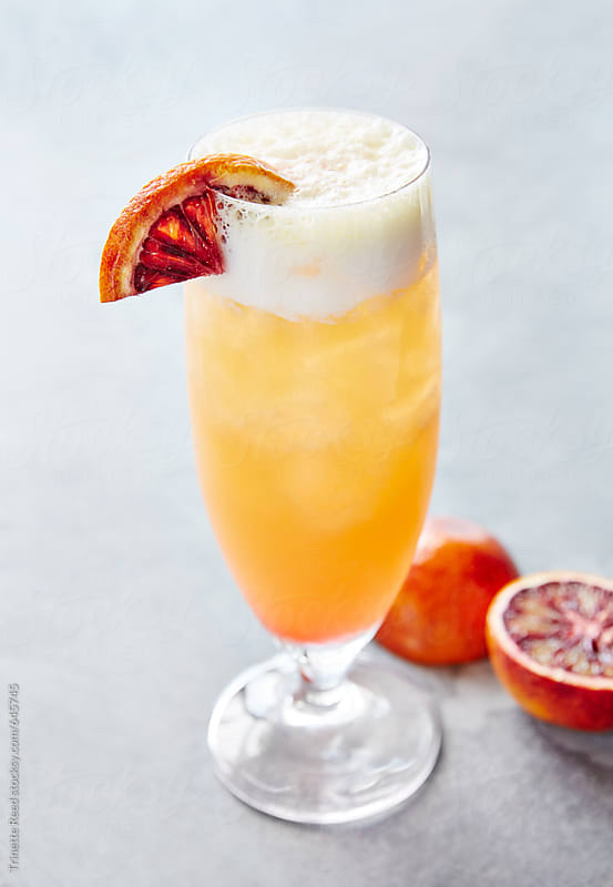 Blood orange signature cocktail on bar by Trinette Reed for Stocksy United
