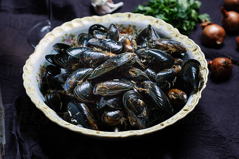 Seafood: Mussels ready to be cleaned and de-bearded before cooking. by Darren Muir for Stocksy United