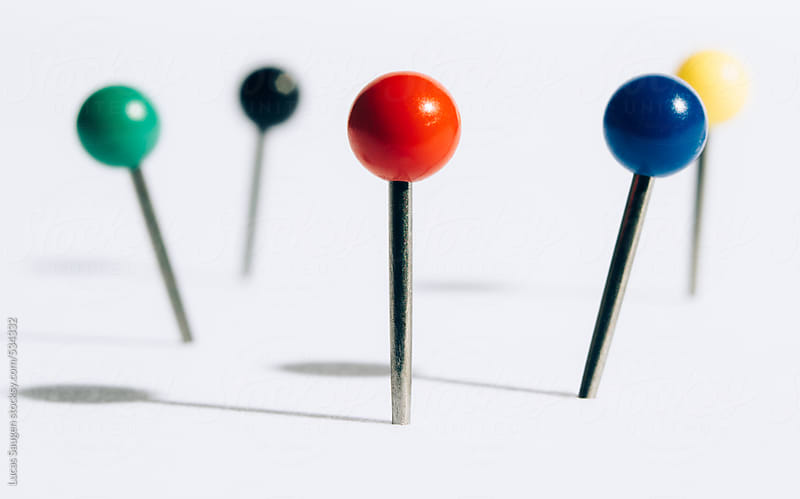 A bunch of push pins in a white foam board. by Lucas Saugen for Stocksy United