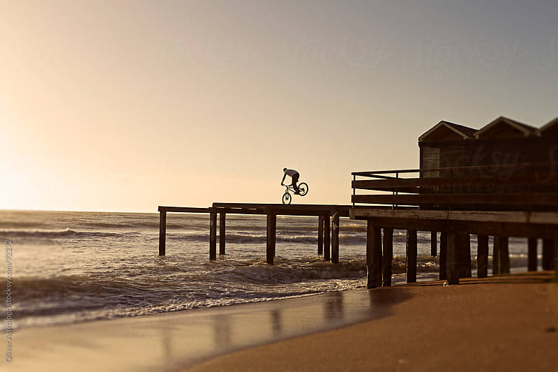 Bicycling on the pier by Oliver Astrologo for Stocksy United