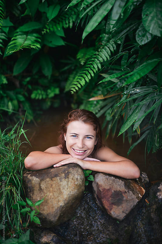 Woman relaxing at hot springs by Alexander Grabchilev for Stocksy United