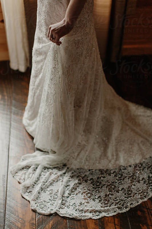 Woman Holding Wedding Dress by Sidney Morgan for Stocksy United