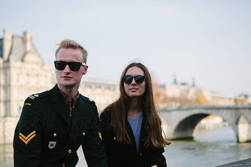 Two friends in front of the River Seine and the Louvre in Paris by kkgas for Stocksy United