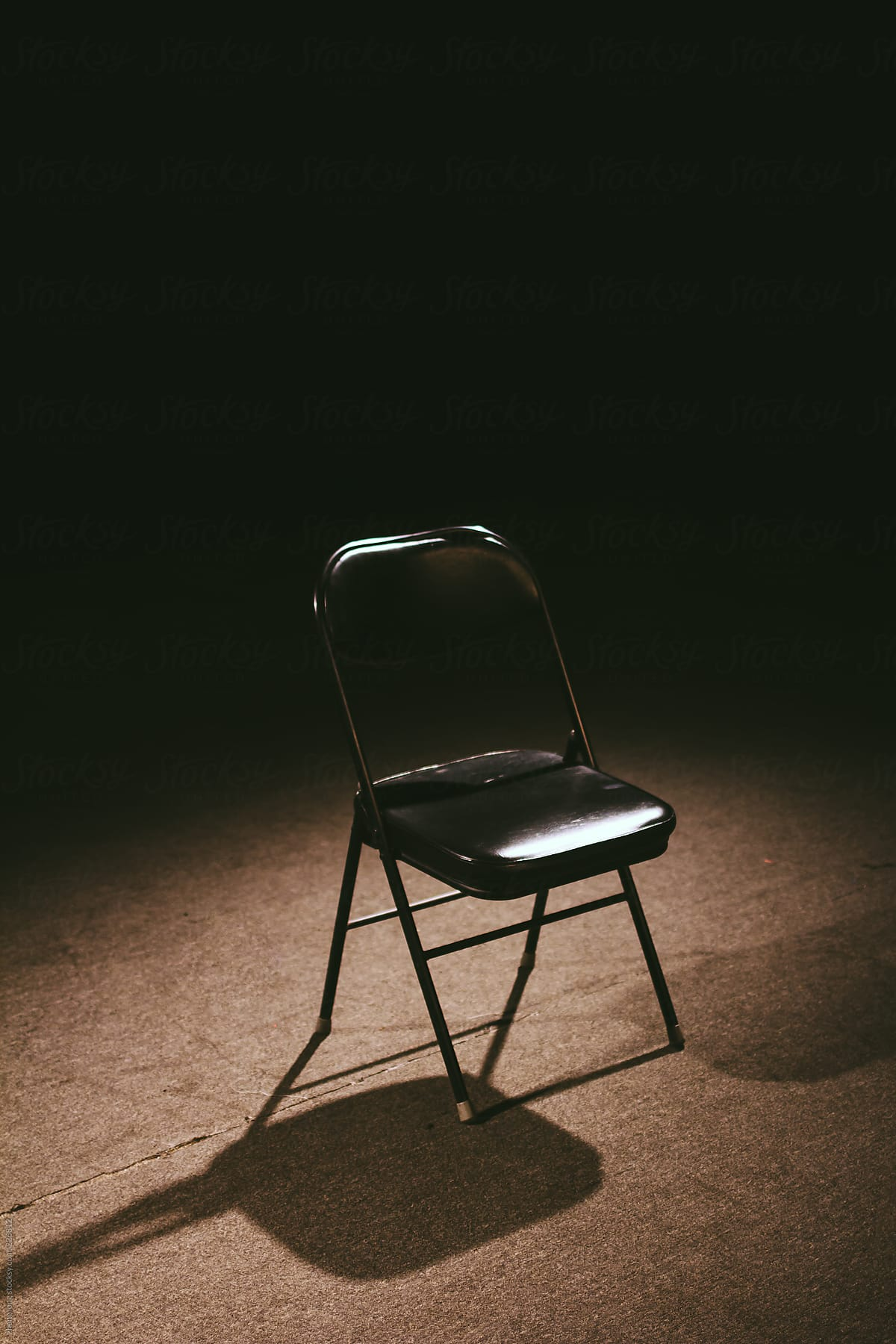 Stupendous Folding Chair Under The Light In The Theatre By Zheng Long Caraccident5 Cool Chair Designs And Ideas Caraccident5Info