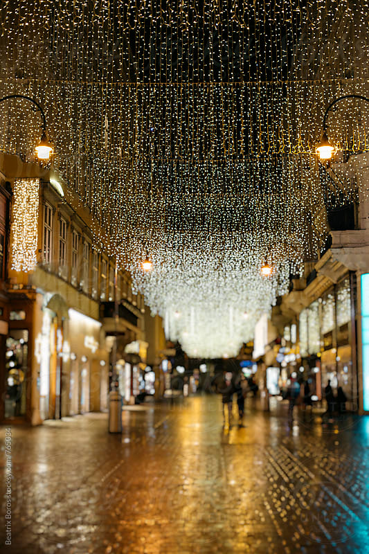 City street decorated for Christmas by Beatrix Boros for Stocksy United