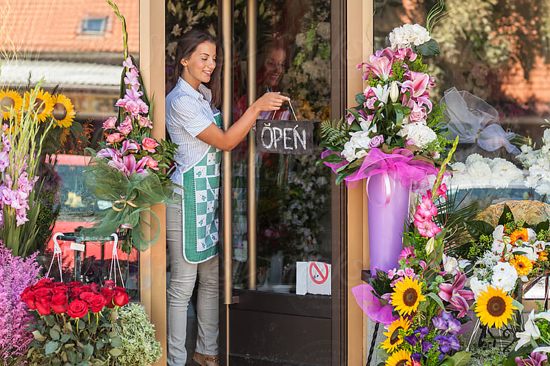 Florist opening her flower shop. by Mosuno for Stocksy United