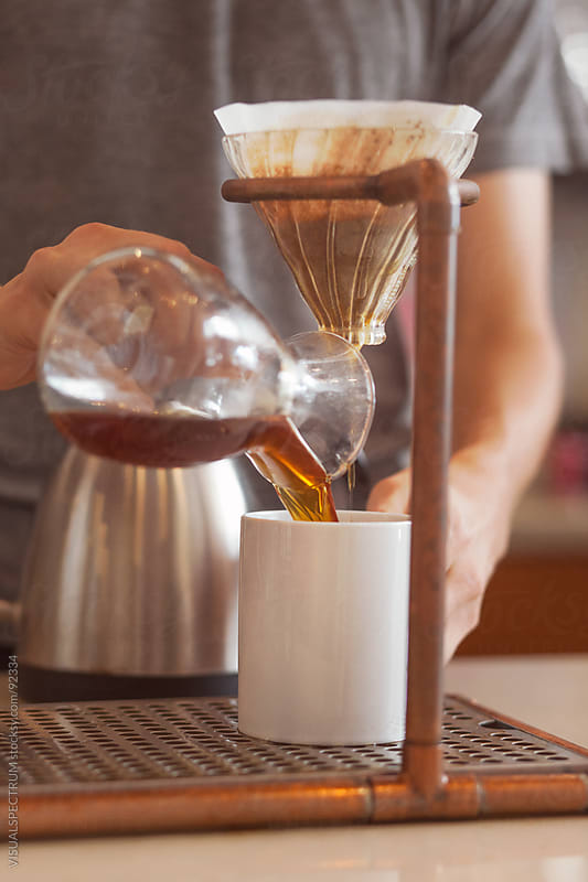Man Pouring Filter Coffee by VISUALSPECTRUM for Stocksy United