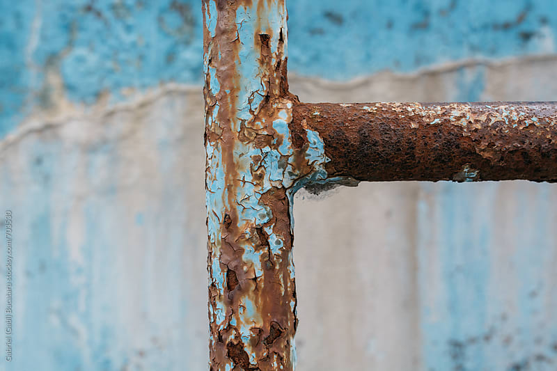 Rusty metallic ladder in a derelict swimming pool by Gabriel (Gabi) Bucataru for Stocksy United