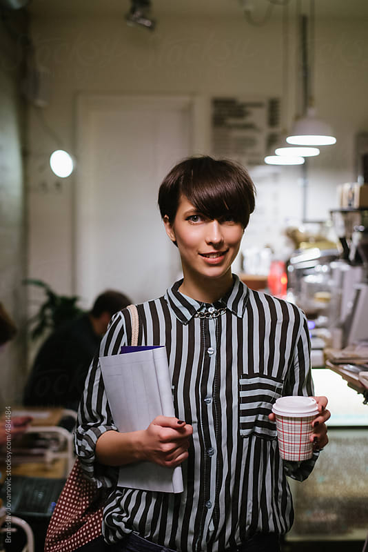 Portrait of a young stylish woman in a coffee shop by Brkati Krokodil for Stocksy United