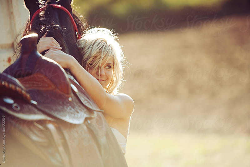 Horse Hugging Woman by Kevin Russ for Stocksy United