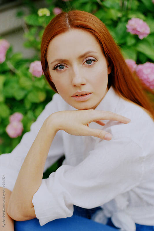 Portrait of the woman with ginger hair and blue eyes by Lyuba Burakova for Stocksy United