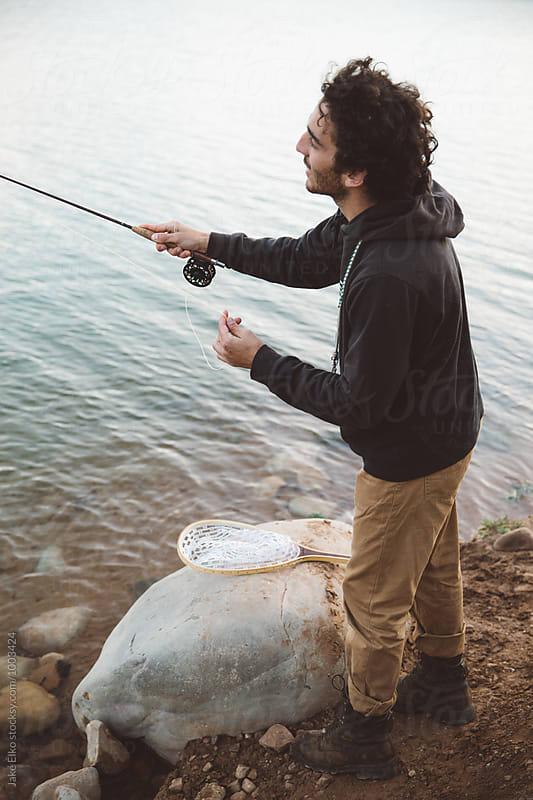 Man Fly Fishing in Utah Lake  by Jake Elko for Stocksy United