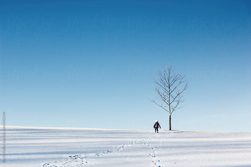 Young Girl Walking up a Hill Towards a Tree by Kevin Keller for Stocksy United