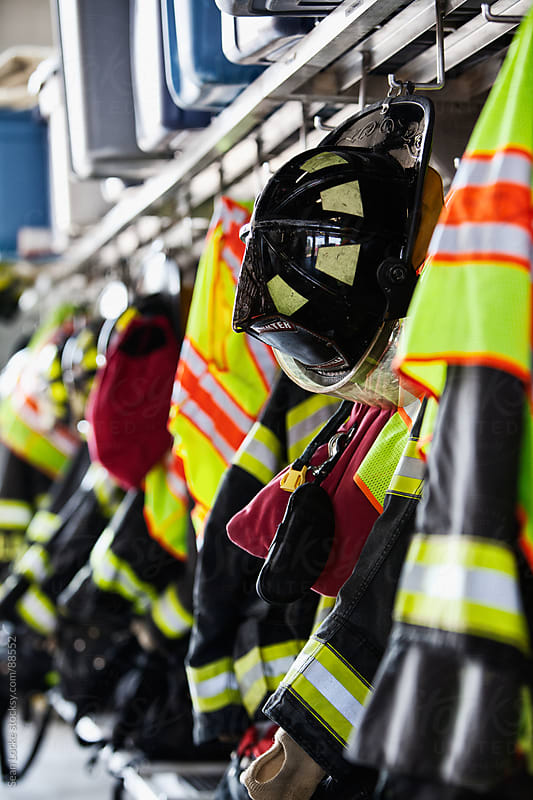 Firehouse: Fire Fighter Gear Hanging On Rack by Sean Locke for Stocksy United