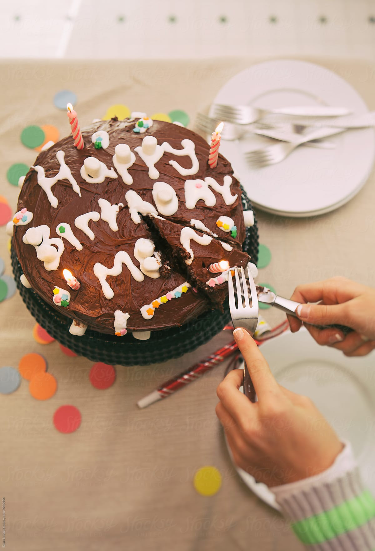 Girl Cutting Slice From Homemade Birthday Cake For Mom Stocksy United