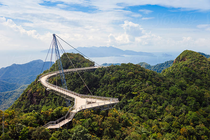 Asia, Malaysia, Langkawi Island, Pulau Langkawi, Hanging suspension walkway above the rainforest canopy at the top of Mount Gunung Machinchang (708m), with views of Langkawi and the Andaman Sea by Gavin Hellier for Stocksy United