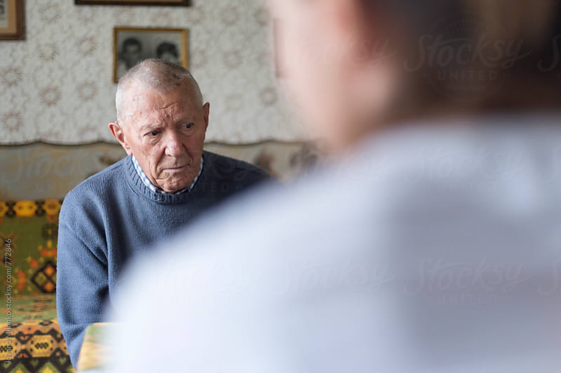 Grandpa having sad expression while receiving news by Jovana Milanko for Stocksy United