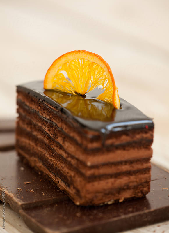 Deliciously looking piece of cake on a table.  by Mosuno for Stocksy United