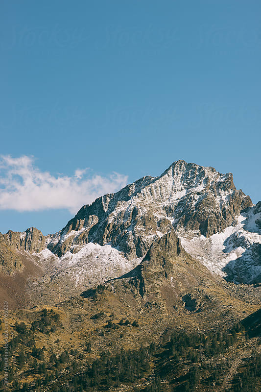 part of the snow-capped mountains with clouds by Javier Pardina for Stocksy United